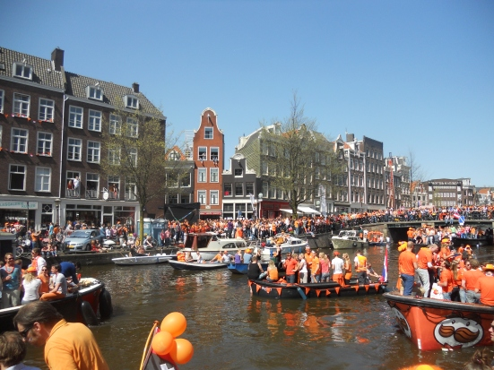 boats fill the canals - Queen's Day, Amsterdam