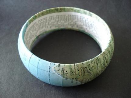 Map covered bangle bracelet